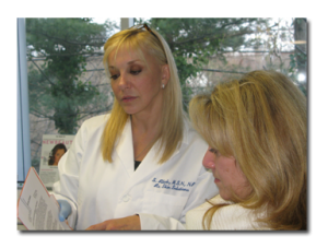 Sara Ribak, MSN FNP Certified Specialist & CEO consulting with a new patient